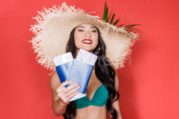 Vrouw zwempak tonen vliegtuig tickets shot Stockfoto © LightFieldStudios