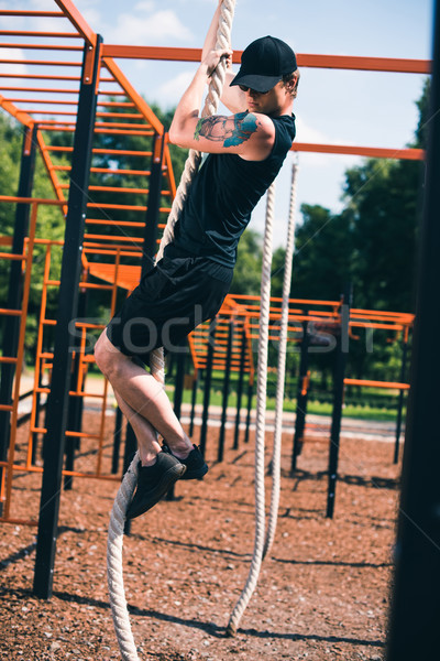Stock photo: man doing rope exercise
