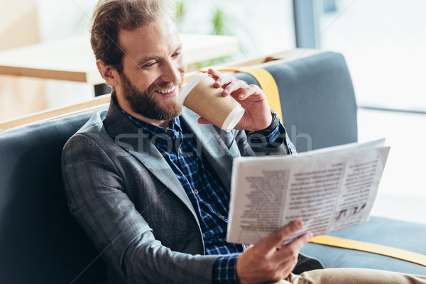 Stock photo: man reading newspaper and drinking coffee