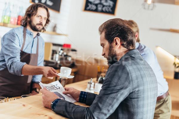 businessman reading newspaper in cafe Stock photo © LightFieldStudios