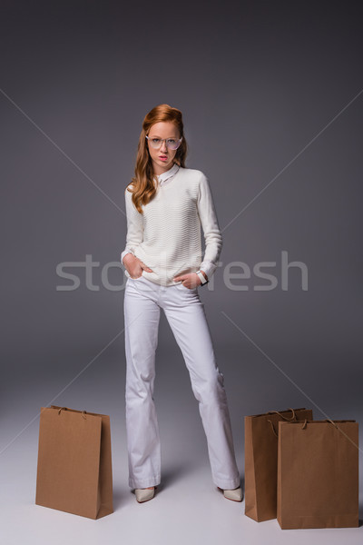 girl in white with shopping bags Stock photo © LightFieldStudios