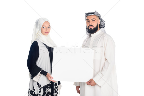 muslim couple holding blank board Stock photo © LightFieldStudios