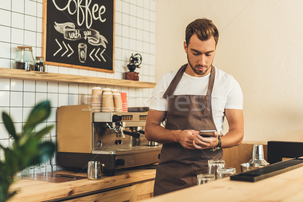 Barista okostelefon portré kötény pult kávézó Stock fotó © LightFieldStudios