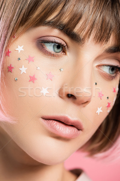 Stock photo: woman with pink stars on face
