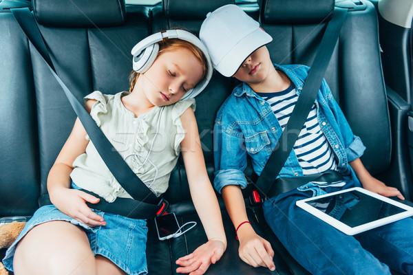 kids sleeping on backseats of car Stock photo © LightFieldStudios