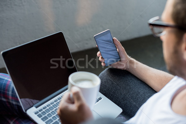 Man with laptop and smartphone Stock photo © LightFieldStudios