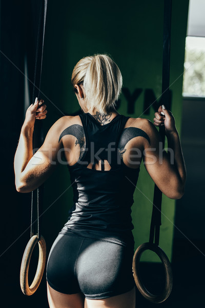 Stock photo: Woman with gymnastic rings