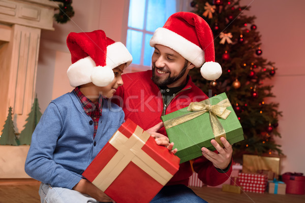 father and son with christmas presents  Stock photo © LightFieldStudios