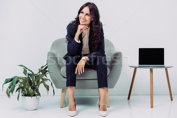 businesswoman sitting in armchair Stock photo © LightFieldStudios