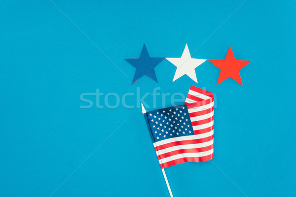 flat lay with arranged american flag and stars isolated on blue, presidents day concept Stock photo © LightFieldStudios