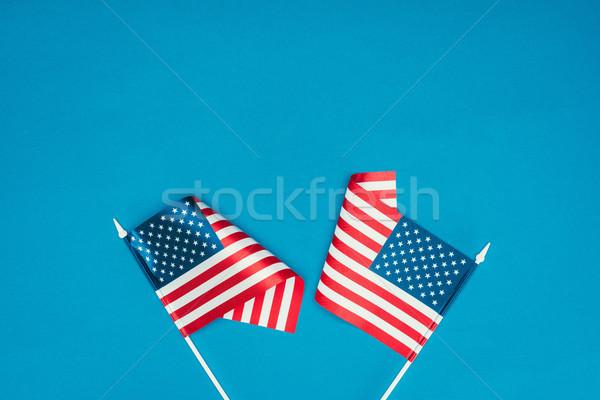 Felső kilátás amerikai zászlók izolált kék Stock fotó © LightFieldStudios