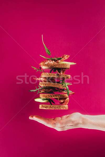 Vue Homme main sandwiches isolé rose Photo stock © LightFieldStudios