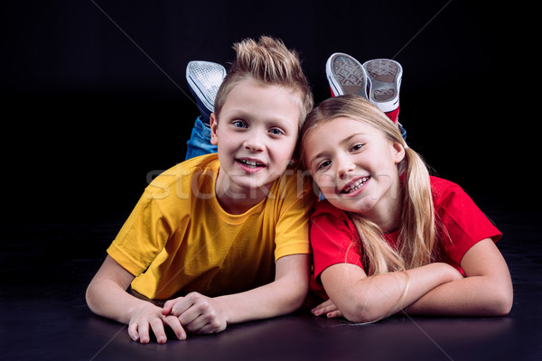 Happy siblings smiling at camera Stock photo © LightFieldStudios