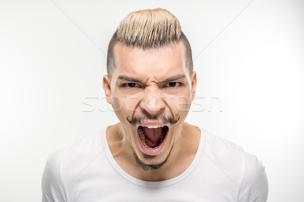 Young man screaming Stock photo © LightFieldStudios