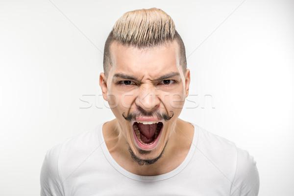 Jeune homme hurlant portrait jeunes élégant homme Photo stock © LightFieldStudios