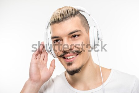 Happy man in headphones Stock photo © LightFieldStudios