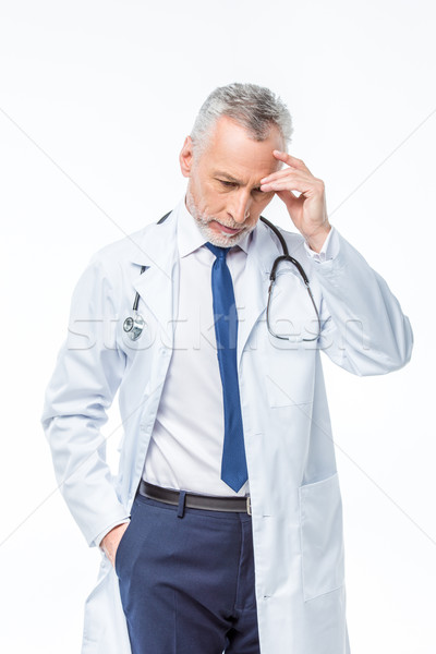 Stock photo: Mature doctor with stethoscope