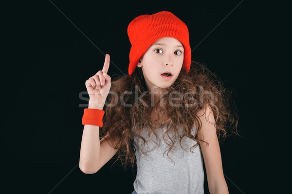 shocked girl in sportive clothing with finger up isolated on black Stock photo © LightFieldStudios
