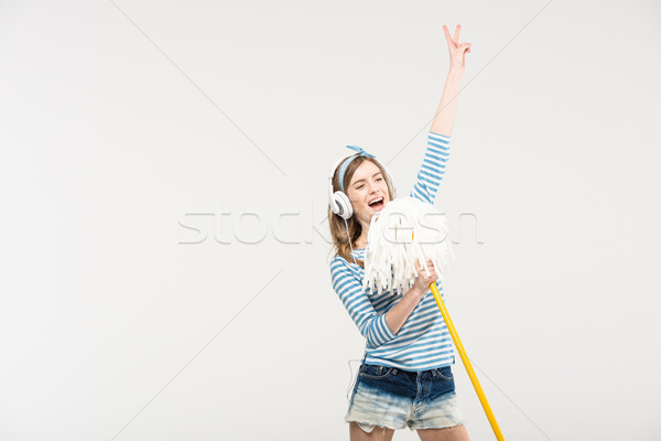 Young woman with mop Stock photo © LightFieldStudios