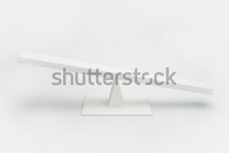 Close-up view of white wooden seesaw balancing isolated on grey Stock photo © LightFieldStudios