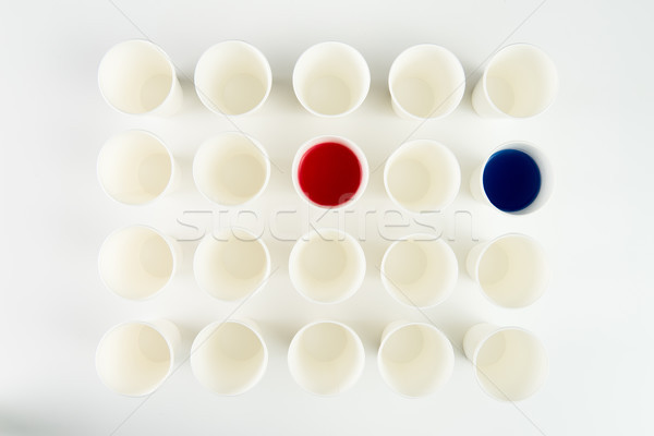 Top view of set of empty plastic cups and cups with red and blue paints   Stock photo © LightFieldStudios