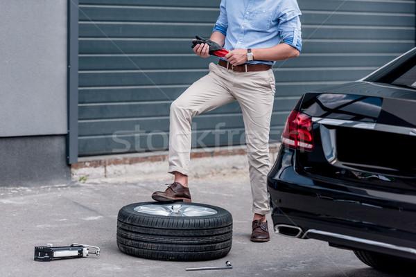 Homem carro pneu ver moço urbano Foto stock © LightFieldStudios