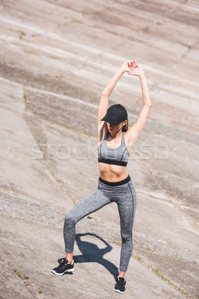 Stock photo: woman stretching on slabs