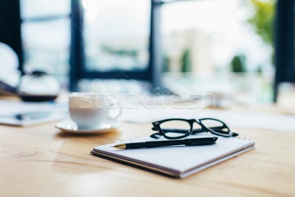 eyeglasses with notebook and pen Stock photo © LightFieldStudios