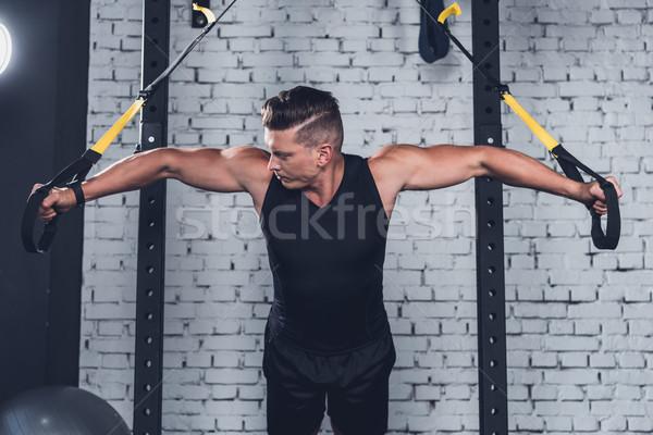 man exercising with trx gym equipment Stock photo © LightFieldStudios