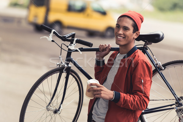 man with bicycle and coffee to go Stock photo © LightFieldStudios