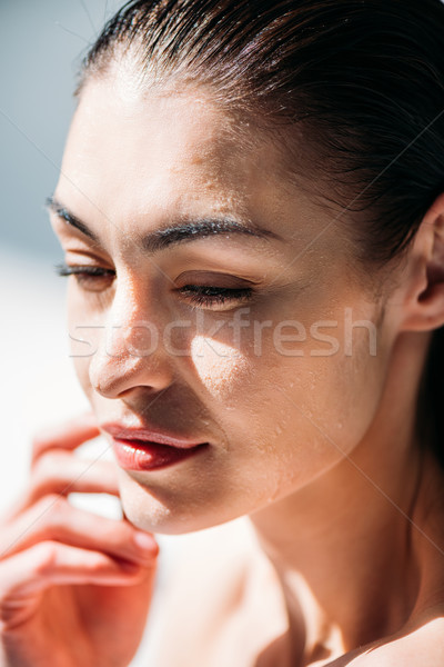 woman with droplets on face Stock photo © LightFieldStudios