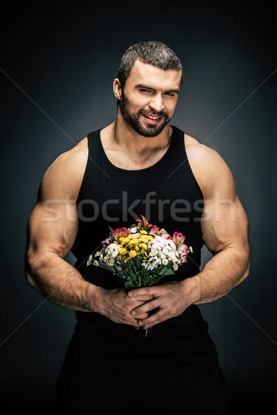Férfi virágcsokor virágok portré mosolyog kezek Stock fotó © LightFieldStudios