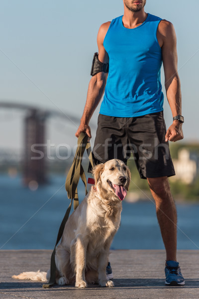 sportsman with dog on quay Stock photo © LightFieldStudios