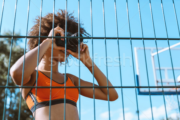 sportive woman taking picture with camera Stock photo © LightFieldStudios