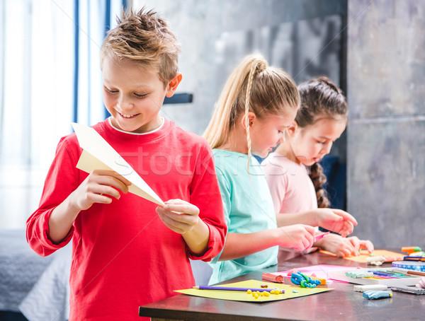 Kid playing with paper plane Stock photo © LightFieldStudios