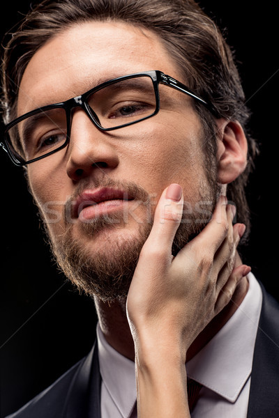 Businessman with female hand on face Stock photo © LightFieldStudios