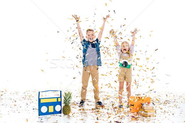 幸せ 子供 紙吹雪 子供 挙手 立って ストックフォト © LightFieldStudios