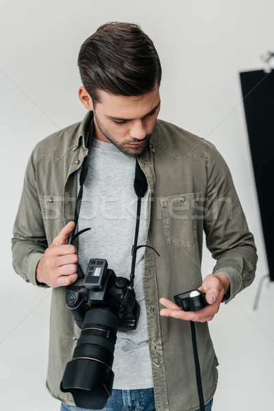 photographer with camera and light meter Stock photo © LightFieldStudios