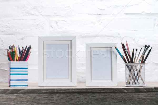 photo frames and office supplies at workplace Stock photo © LightFieldStudios