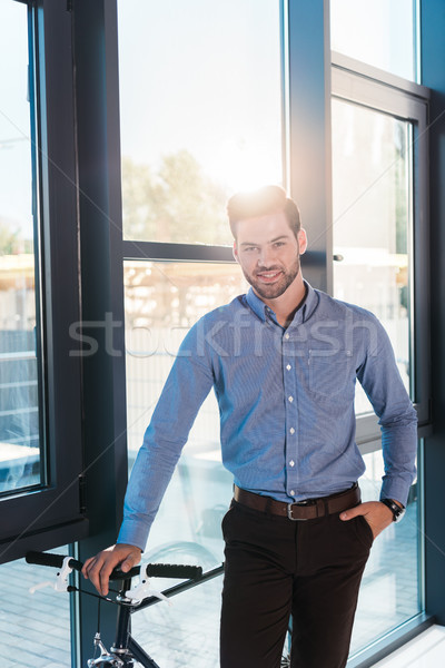 businessman with bicycle in office Stock photo © LightFieldStudios