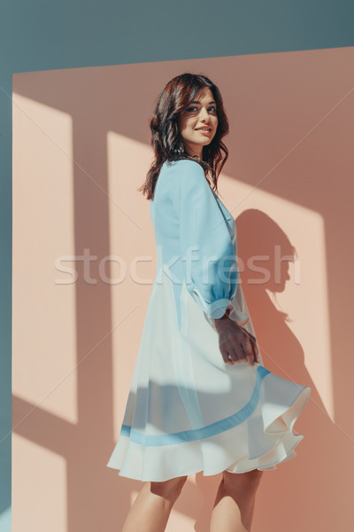Femme mode turquoise robe belle femme permanent Photo stock © LightFieldStudios