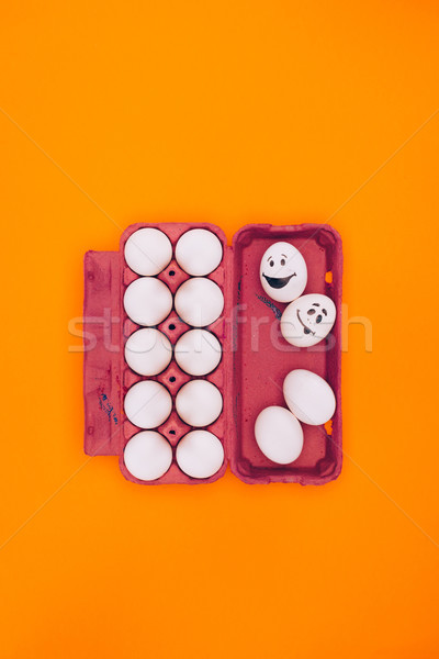 top view of chicken eggs in egg tray for easter painting isolated on orange Stock photo © LightFieldStudios