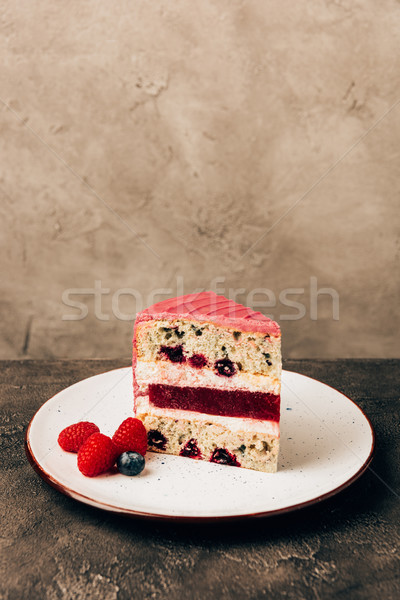 close-up view of sweet delicious cake with berries on plate Stock photo © LightFieldStudios