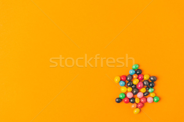 top view of star made of sweets isolated on orange, purim holiday concept Stock photo © LightFieldStudios