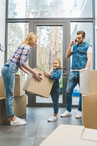 young family moving into new house Stock photo © LightFieldStudios