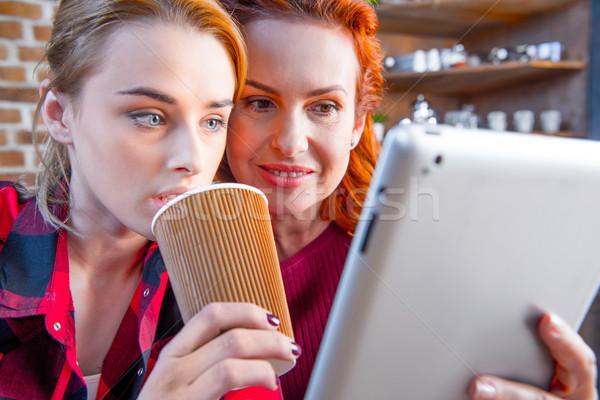 Women using digital tablet Stock photo © LightFieldStudios
