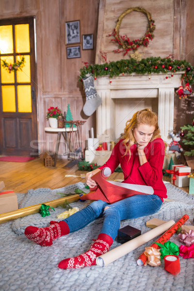 Girl with rolls of wrapping paper Stock photo © LightFieldStudios