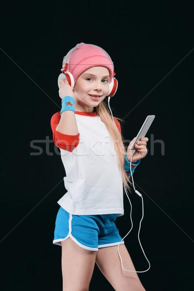 Cute fille casque smartphone isolé Photo stock © LightFieldStudios
