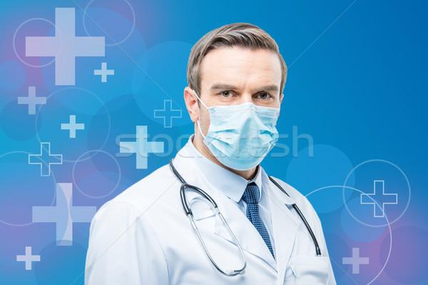 Confident doctor with stethoscope  Stock photo © LightFieldStudios