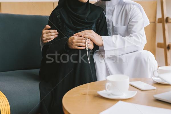 muslim couple embracing on cozy sofa Stock photo © LightFieldStudios